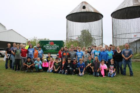 Seventh and eighth grade students weeded squash fields and picked more 15,000 ears of corn in three hours at Forgotten Harvest Farm in Fenton.