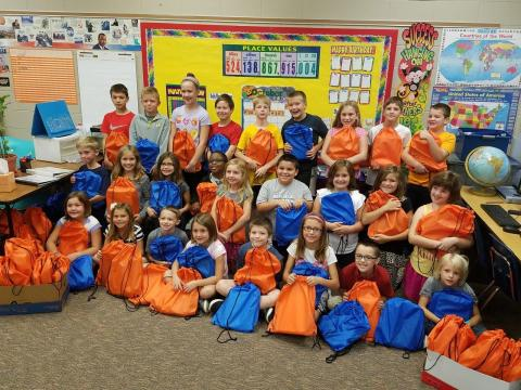 St. Matthew families donated school supplies for needy children. Third and fourth grade students assembled 212 school kits for Lutheran World Relief to distrubute.