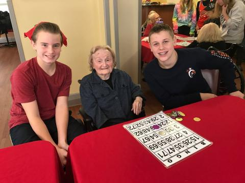 Eighth graders had an opportunity to be the hands and feet of Jesus by traveling to the West Bloomfield Orchard Villa Nursing Home to spend a little time with their residents.  The students enjoyed assisting the residents with Bingo, while engaging in del
