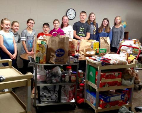 """Student Council hosted a """"Packing the Pantry for Pontiac"""" breakfast. This event brought in 764 pantry items, plus $45 in cash donations for our sister congregation, St. Paul, to help feed their community in Pontiac."""